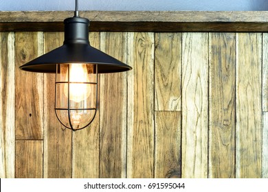 Light bulb on wood wall : country style.