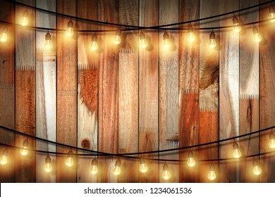Light bulb on wooden background ,Space for your task or message. Valentine's Day concept and New year day