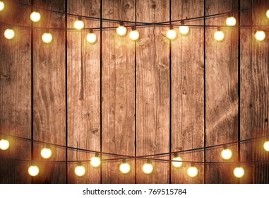 Light bulb on wooden background ,Space for your task or message.
