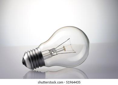 Light Bulb over grey background