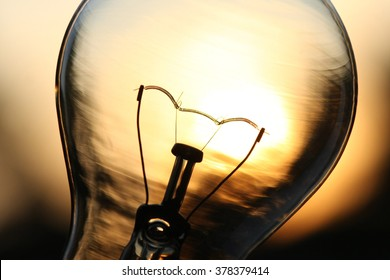 Light bulb over sunlight