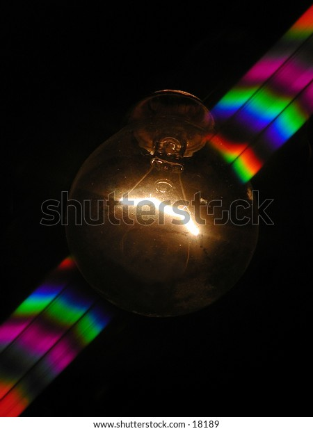 Light bulb with rainbow coming out from both sides.