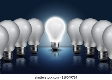 Light bulb in a row with middle light bulb on. Concept for outstanding key person