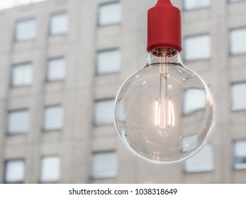 Light bulb single with house background
