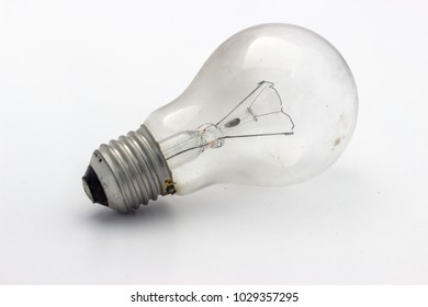 Light bulb torn tungsten filament on white background