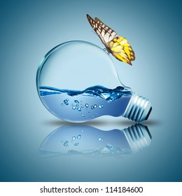 Light bulb with water inside and butterfly on the bulb. Concept for new idea of environment conservation