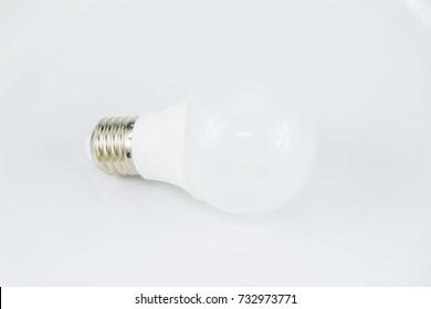 Light bulb in white background