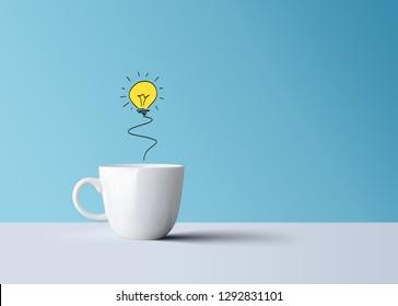 light bulb in white coffee mug, creative idea