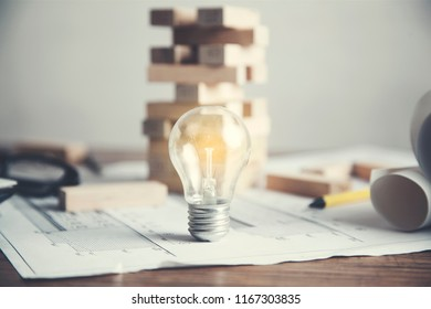 light bulb with wooden cubes