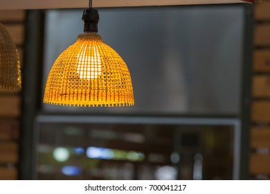 Light bulb and yellow lamp as interior design concept.
