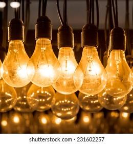 Light bulb,Hanging glowing light bulbs on black background,Lighting decor,chandeliers