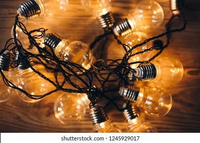 Light bulbs as Christmas light garland. Flat lay, top view. X-mas background.