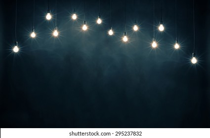 Light bulbs on dark blue background