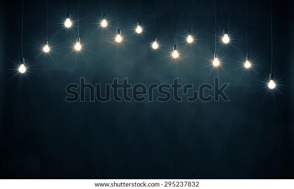 Light bulbs on dark blue background