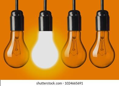 Light bulbs on orange background