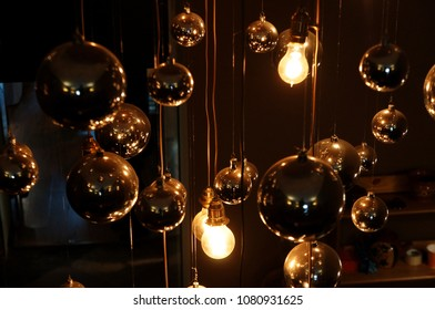 Light bulbs on wires in the dark
