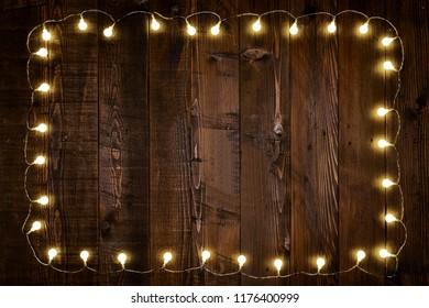 light bulbs on wooden background