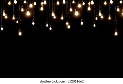Light bulbs over dark texture