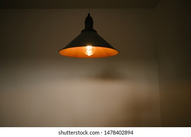 Light bulbs over white wall background
