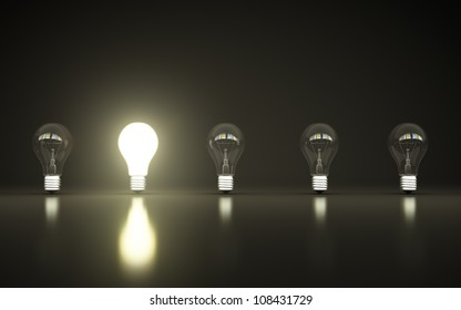 light bulbs stand in rows one glows