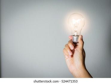 Light bulk in woman hand,concept idea.