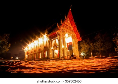 the light from the candle lit at night around the Church of Buddhist Lent.