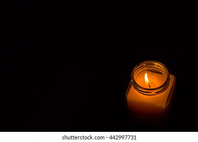 Light candles in glass.