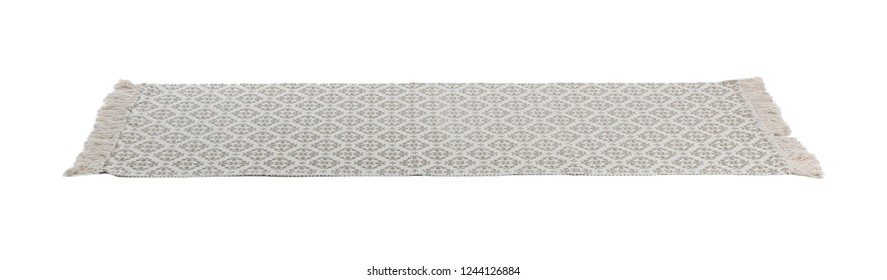 Light carpet with ornament on white background. Interior element