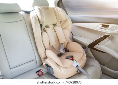 light children's car seat in a bright leather interior