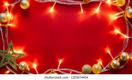 light and Christmas decoration on red paper for new year and Christmas concept background