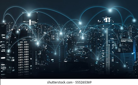 light of city at night and network connections for business and technology concept