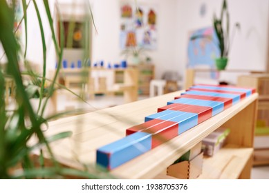 Light class in Montessori kindergarten. The colorful numeric rods in the foreground. nobody.