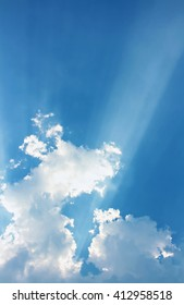 Light and clouds on blue sky