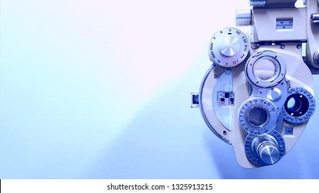 Light colored phoropter on blue background