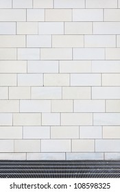 Light colored street wall, may be used for background or design
