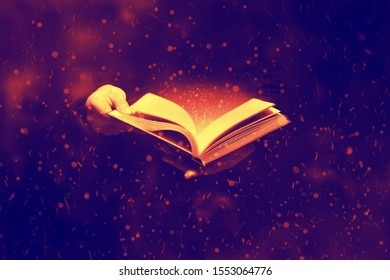 Light coming from book  in hands
