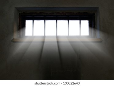 Light is coming through the barred window, hope concept