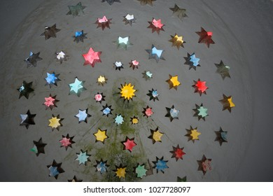 Light coming through multicolored stars in a ceiling
