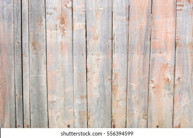 light coral old wooden fence. wood palisade background. planks texture
