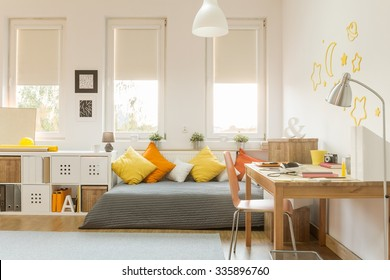 Light cozy teen room with color decorations