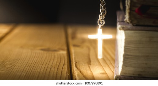 Light of cross with holy bible.Christian, Religion background.