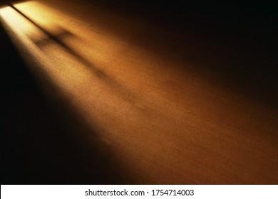 Light and cross shadow on wooden board, dark room, light and hope, faith