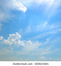 Light cumulus clouds in the blue sky.