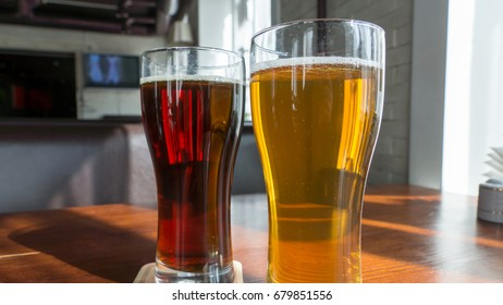 Light and dark beer in glass glasses