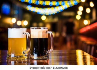 light and dark beer on a pub background.