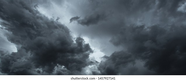 Light in the Dark and Dramatic Storm Clouds background
