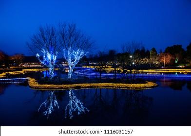 Light decoration reflecting on the water surface at Nabana no Sato, Mie, Japan