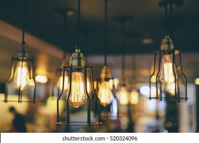 Light, design and interior. Vintage metallic lanterns.
