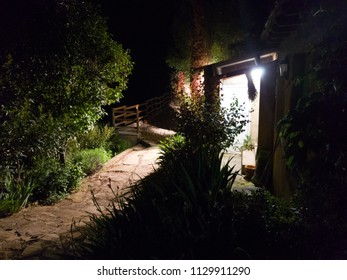 light at the door of country house at night.