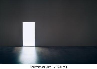 Light door in dark room.Hope concept